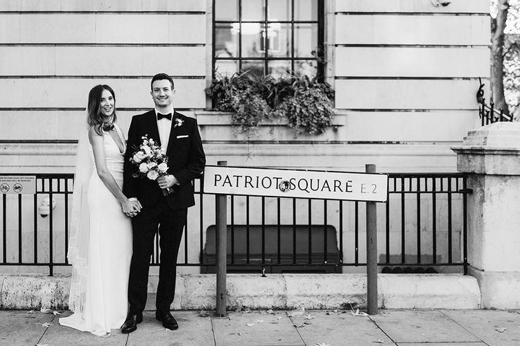 Bride and Groom relaxed wedding with East London road sign