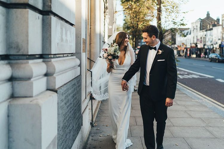 Bride and Groom take a moment to enjoy their relaxed autumn city wedding