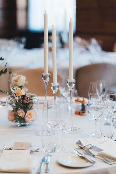 Dusky pink and apricot table centrepieces at city wedding in London