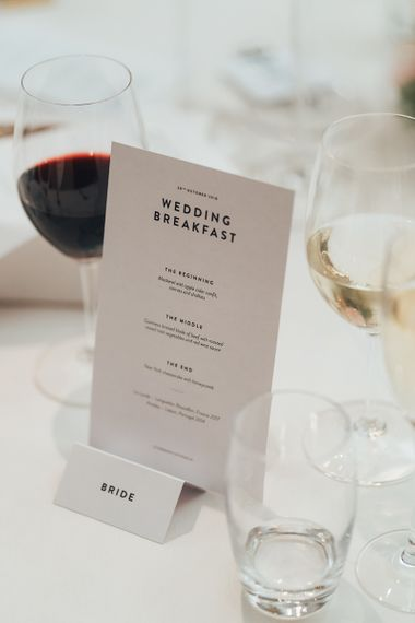 Personalised monochrome menus for Wedding Breakfast at city wedding with black bridesmaid dresses