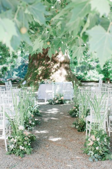 Green and Peach Outdoor Aisle Wedding Flowers