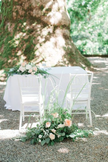 Altar Chairs with Green and Peach Floral Arrangements
