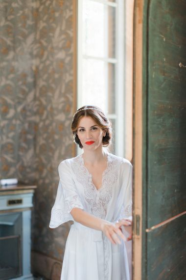 Beautiful Bride with Red Lipstick in White Getting Ready Robe,