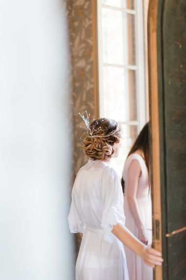 Beautiful Bride with Bridal Up Do in White Getting Ready Robe,
