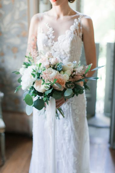 Bride Holding a Peach, Pink and White Bouquet  in Lace Atelier Eme Wedding Dress