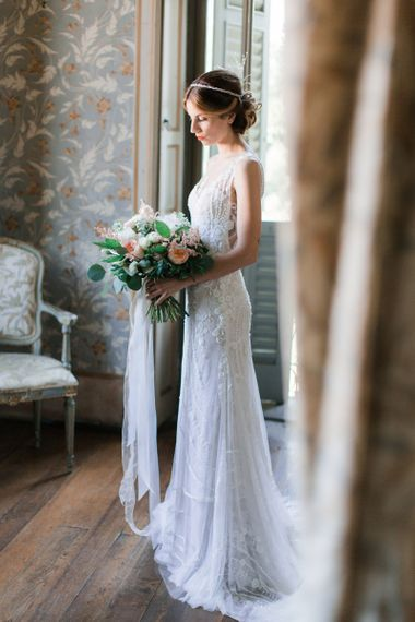 Bride Holding a Peach, Pink and White Bouquet  in Lace Atelier Eme Wedding Dress and Headdress