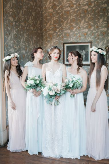 Bridal Party with Bride in Lace Atelier Eme Wedding Dress and Bridesmaids in Peach and White Dresses