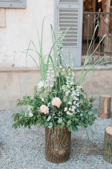 Tree Stump Floral Arrangement with Foliage and Pink Flowers