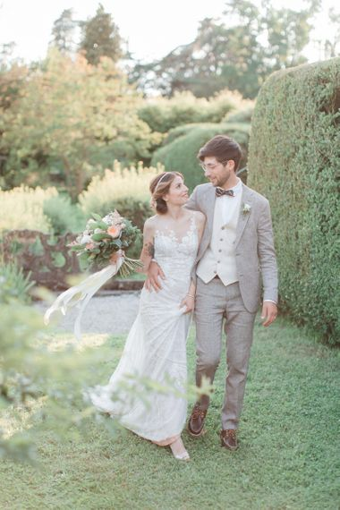 Bride in Lace Atelier Eme Wedding Dress and Groom in Beige Suit