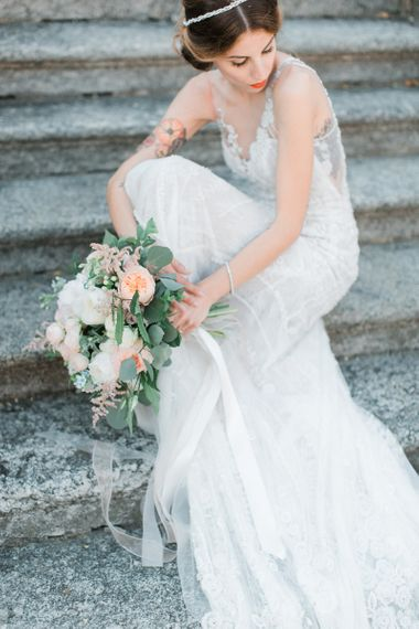 Bride in Lace Atelier Eme Wedding Dress with Romantic Bridal Bouquet with Ribbons