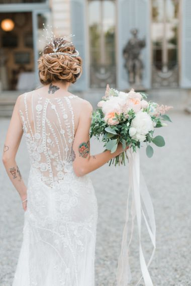 Bride in Atelier Eme Wedding Dress with Lace Back and  Bridal Up Do