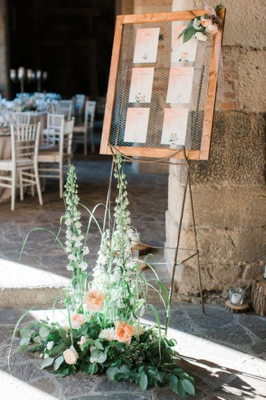 Wooden Table Plan with chicken Wire and Blush Wedding Stationery