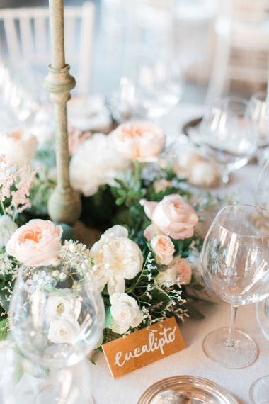 Peach and White Floral Arrangement with Gold Name Cards