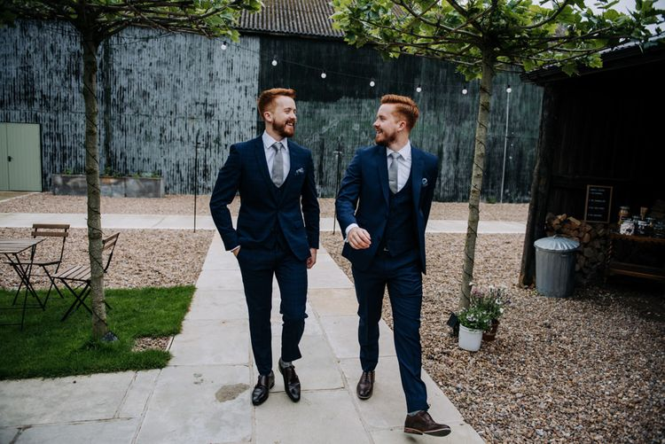 Groom and Twin Brother in Three-piece Navy Suits
