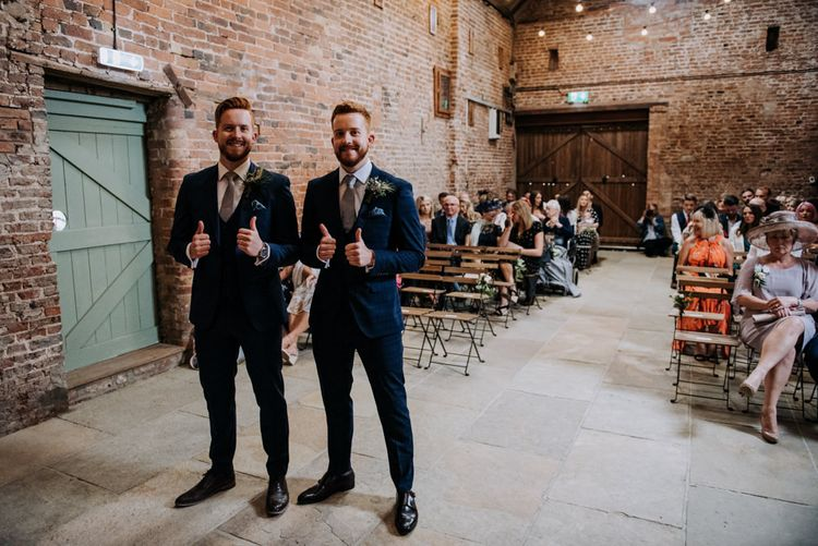 Groom and Twin Brother Best Man at the Altar in Navy Suits