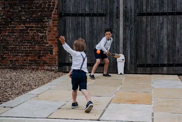 Little Wedding Guests Playing Cricket