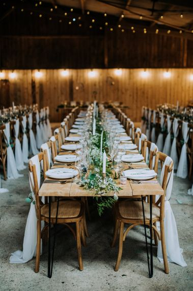 Wooden Tablescape with Greenery Garland and Candle Wedding Decor