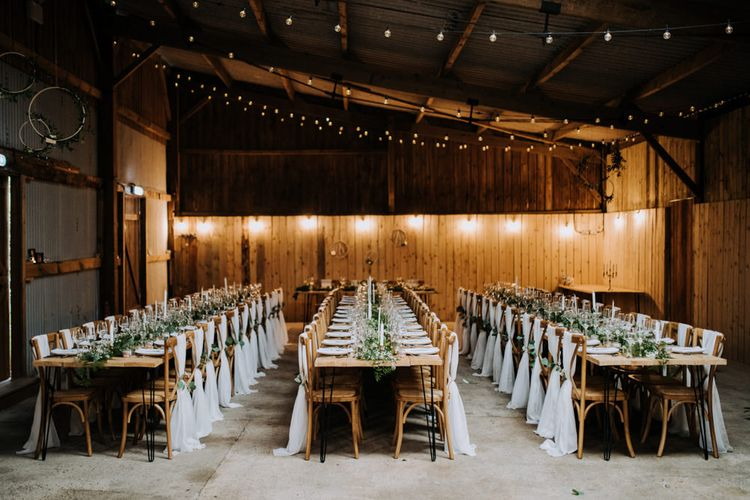 Rustic Barn Wedding Reception with Drape Chair Back Decor, Foliage and Candle Light Centrepieces