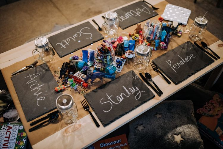 Children's Table with Slate Place Settings, and Pencils and Activities as Centrepiece