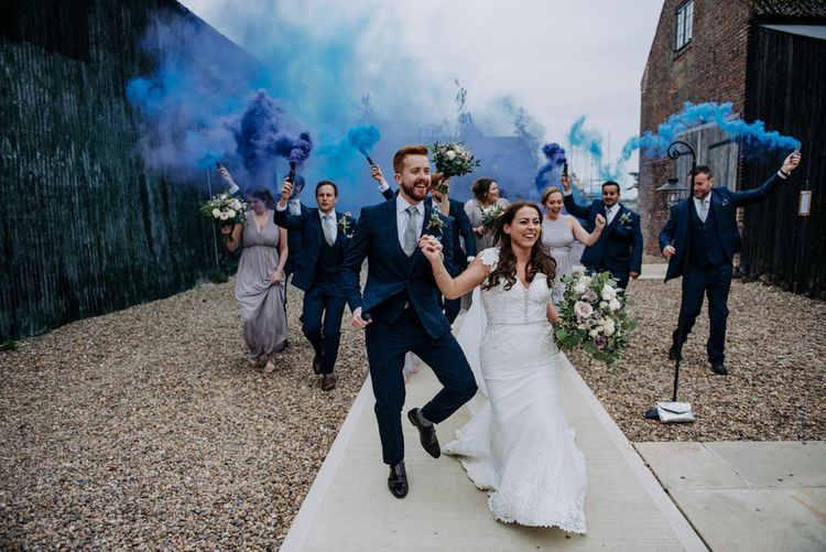 Wedding Party Holding Blue Smoke Bombs
