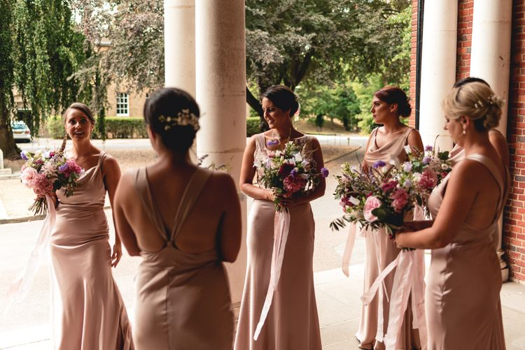 Pink Bridesmaids Dresses By Jarlo London // Image By Peter Hughes Photography
