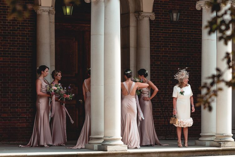 Sandhurst Military Academy Marquee Wedding With Bride In Pronovias Bridesmaids In Pink Dresses By Jarlo London Images From Peter Hughes Photography