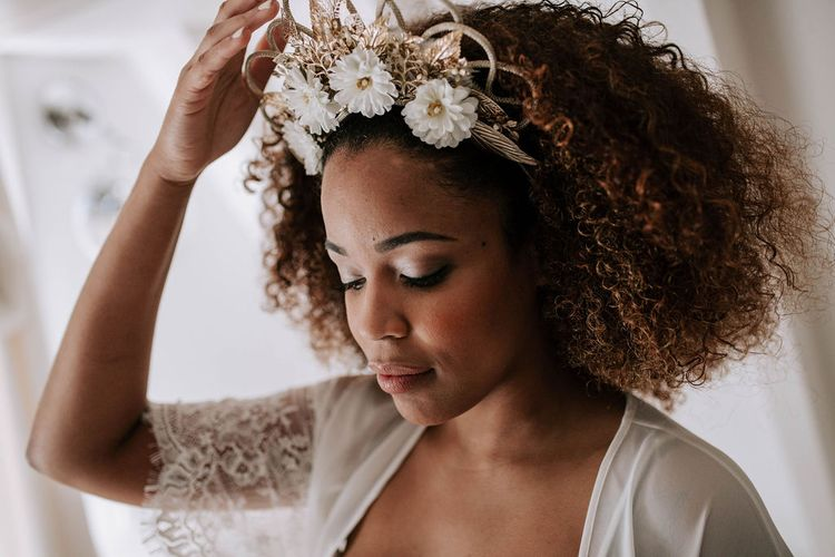 Beautiful Black Bride with Afro Hair in Getting Ready Robe and  Gold Headdress