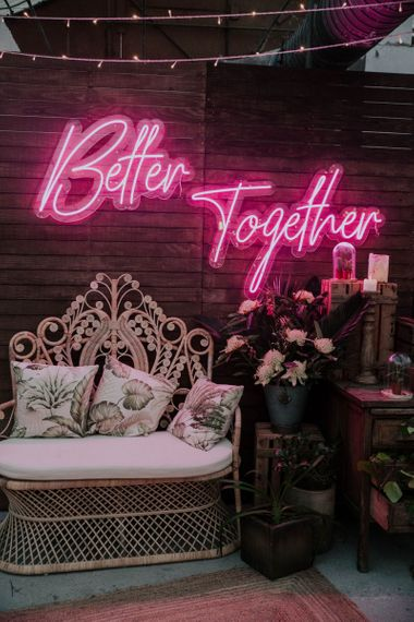 Chill-out Zone with Wicker Chair and Pink Neon Better Together Sign