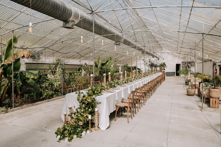 Fundación Sales Glasshouse Wedding Venue with Botanical Plants, Greenery Table Runner and Wooden Candlesticks