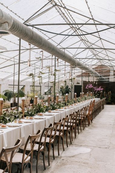 Glasshouse Wedding Venue with Tablescape with Galician camellias centrepiece and wooden candlesticks