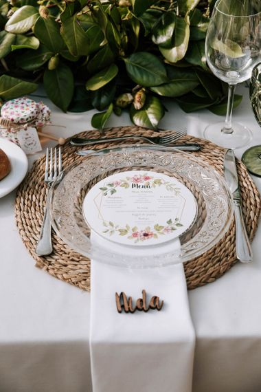 Place Setting with Wicker Place Mat, Glass Platter and  Floral Menu Card