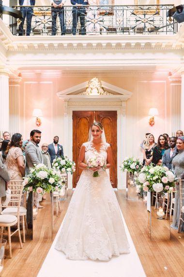 Bride Walking Down the Aisle Alone in a Lace Pronovias Wedding Dress