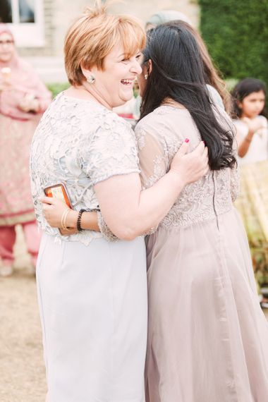Mother of The Bride and Wedding Guest Embracing