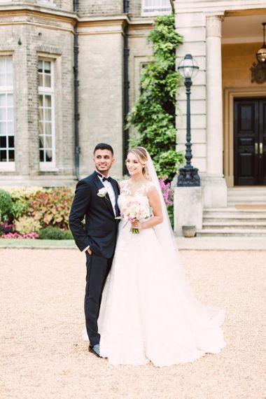 Bride in Lace Pronovias Wedding Dress and Groom in Black Tie Suit