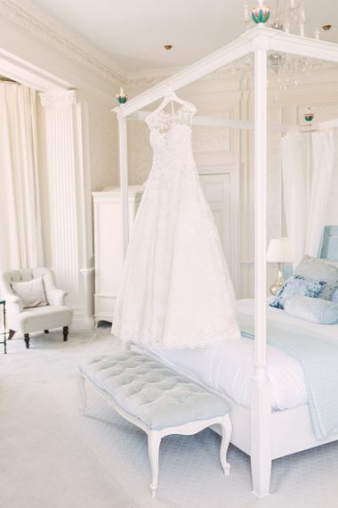 Lace Princess Style Pronovias Wedding Dress Hanging Up in the Bridal Suite on the Morning of the Wedding