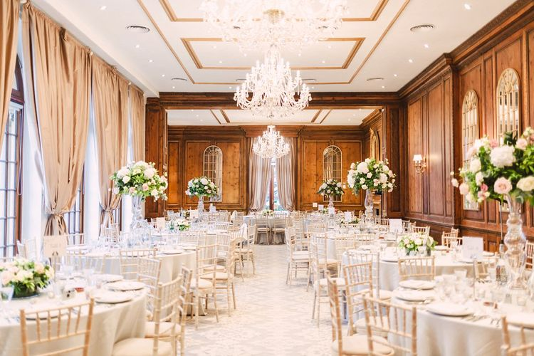 Header House, Buckinghamshire Wedding Reception with Chandelier and Tall Floral Centrepieces