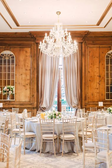 Header House, Buckinghamshire Wedding Reception with Chandelier and Low Floral Centrepieces