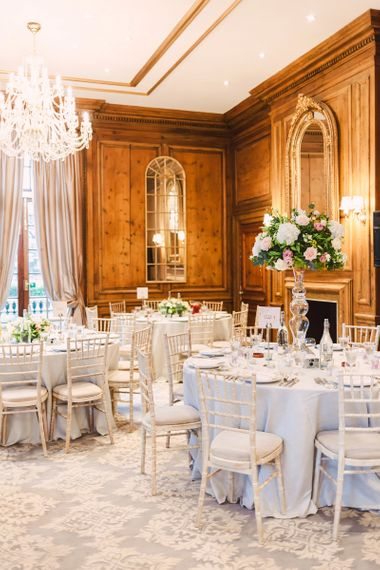 Header House, Buckinghamshire Wedding Reception with Floral Centrepieces and Fireplace Decor
