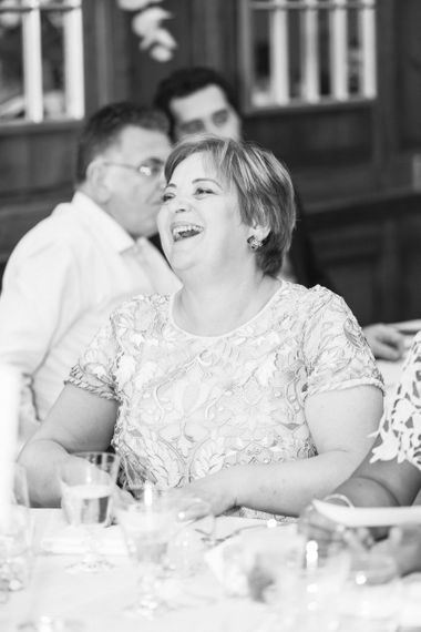 Mother of the Bride Laughing During The Wedding Reception Speeches