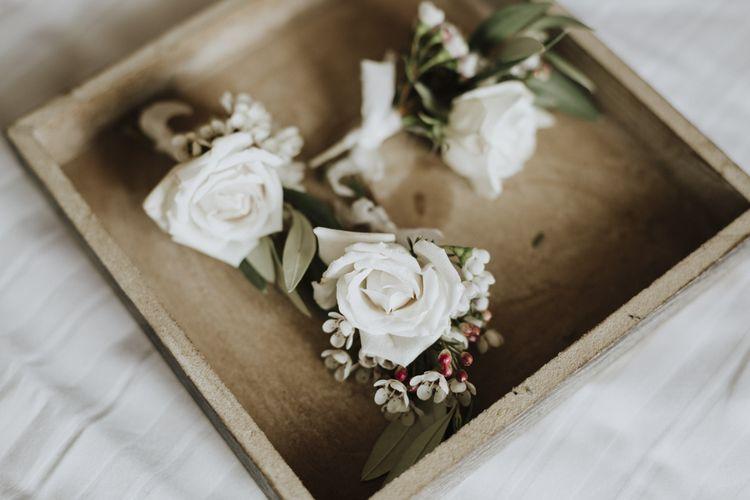 White wedding buttonholes