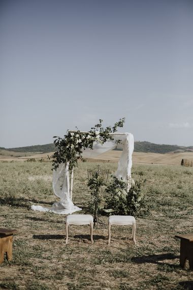 Wedding ceremony decor with flowers and drapes