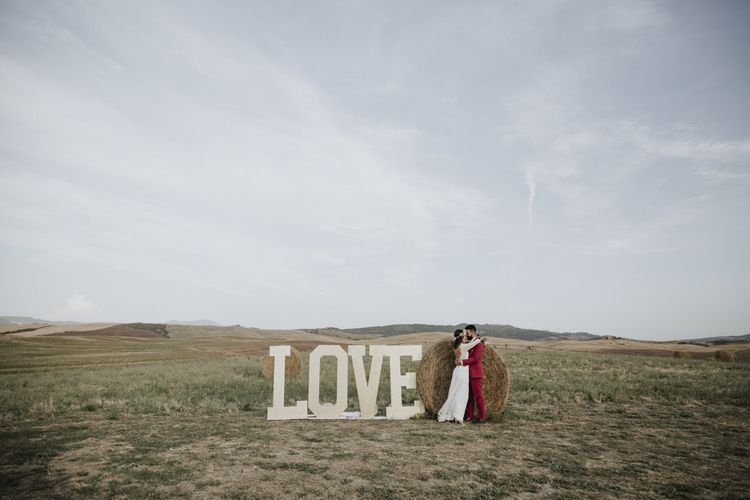Italian wedding with large 'LOVE' letters