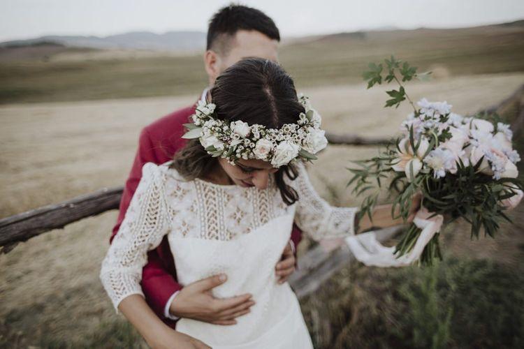 Bridal bouquet and flower crown for bride in  Laure de Sagazan wedding dress