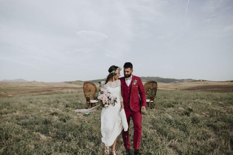 Red wedding suit for groom with Laure de Sagazan bride dress