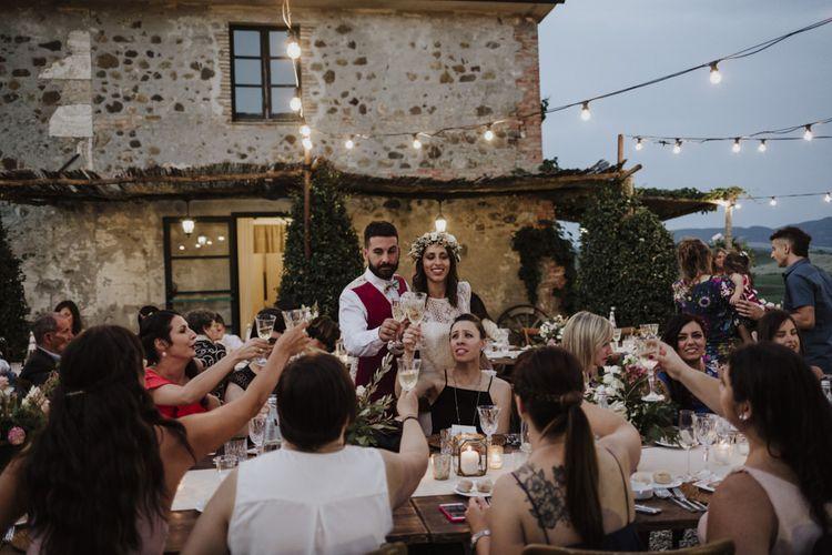 Festoon lighting for outdoor wedding dinner