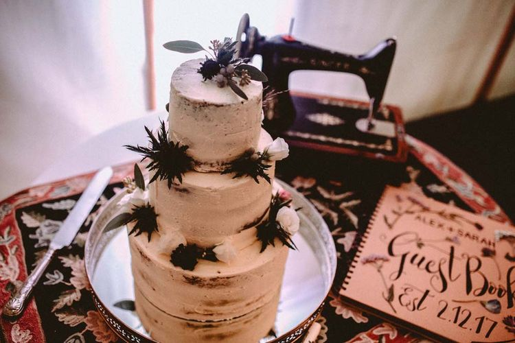Semi Naked Wedding Cake With Thistles // Winter Wedding Yorkshire Dales With Bridesmaids In Bespoke Silvery Dresses By Hope And Ivy With Images From Carla Blain Photography