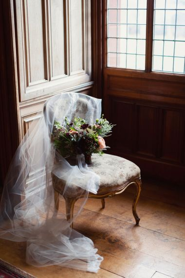 Winter Wedding Bouquet and Veil on Antique Chair