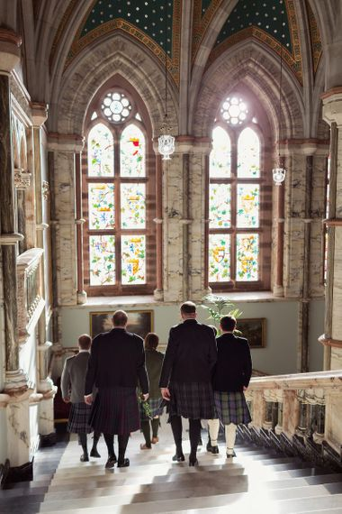 Groomsmen in Traditional Scottish Highland Fling Kilts Walking Down Mount Stuarts Grand Hall