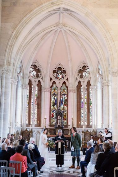 Church Wedding Ceremony with Bride in Delicate Lace Lihi Hod Sophia Wedding Dress with Long Sleeves and Groom in Traditional Tartan Kilt at the Altar