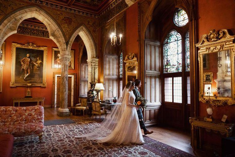 Bride in Delicate Lace Lihi Hod Sophia Wedding Dress with Long Sleeves and Groom in Traditional Tartan Kilt